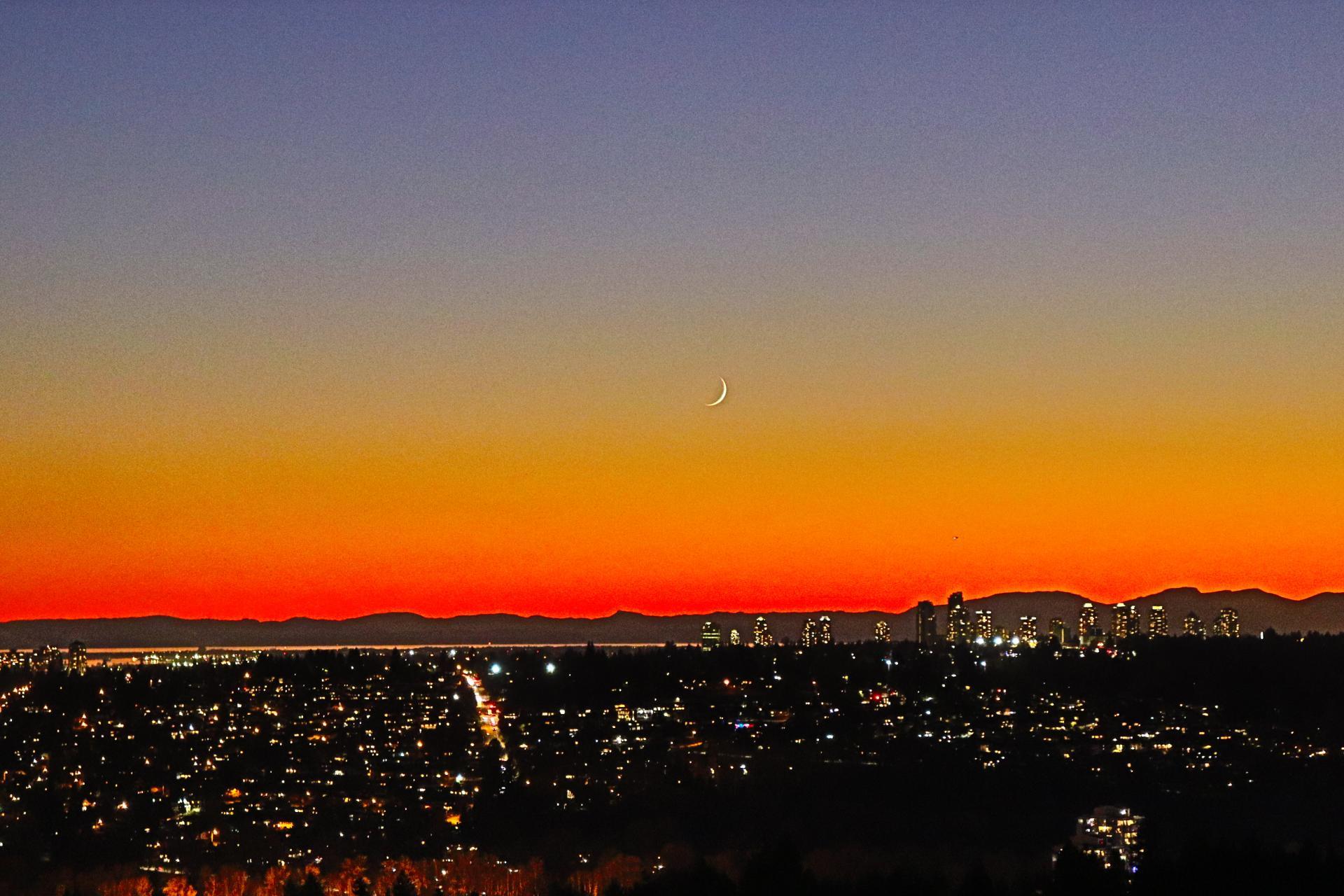 Moon over skyline