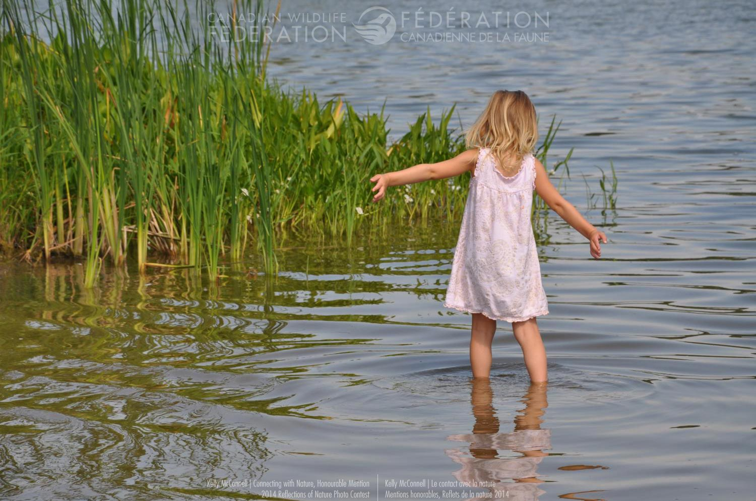Girl wandering into a lake
