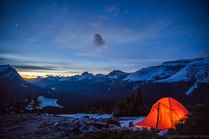 Camping in snowy starlit mountains