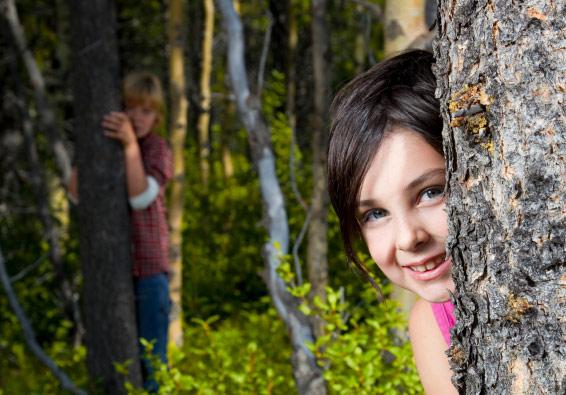 girl child kid hiding tree play