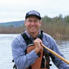 Bob Henderson paddling a canoe