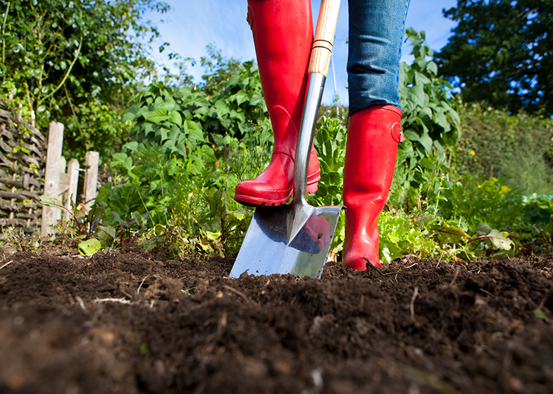 gardening with red boots