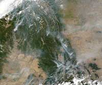 Forest fires can be seen blazing across British Columbia, August 21, 2003.