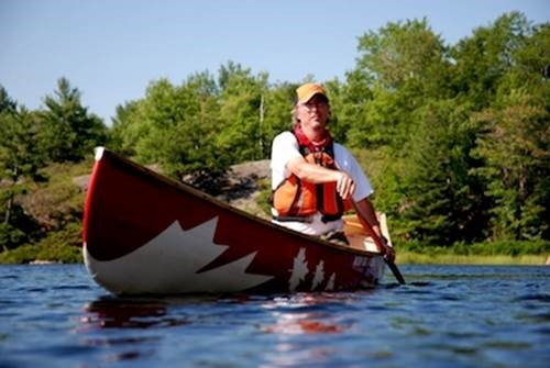 Kevin Callan canoeing on a lake