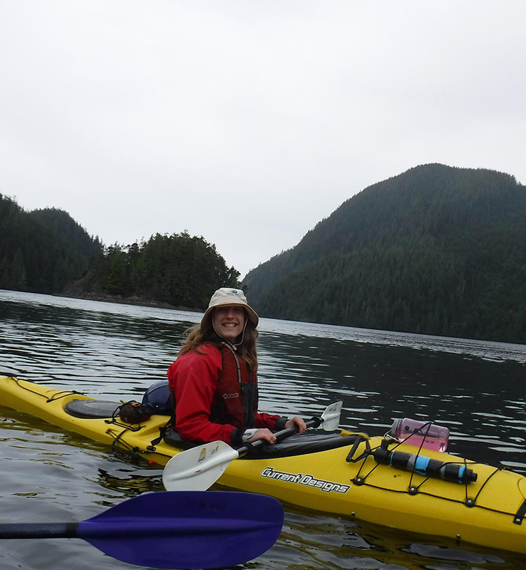 canadian conservation corps member in canoe