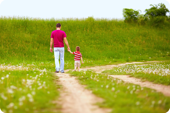 Father and son walking in the countryside