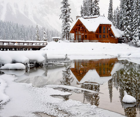 Cabin in the winter on a lake