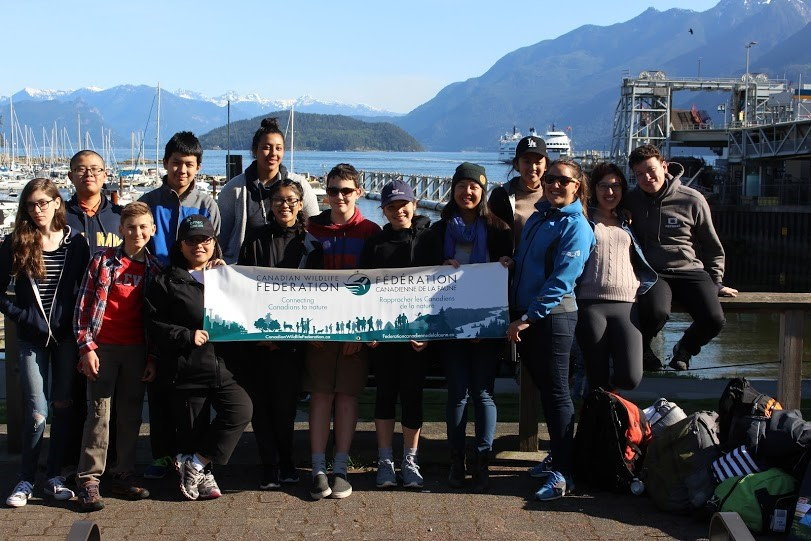 Youth with CWF banner in Vancouver