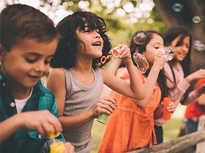 kids outside bubbles